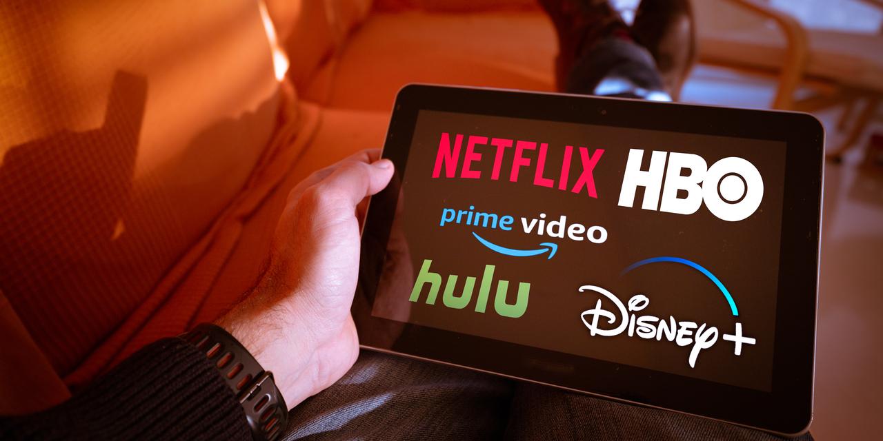 Netflix Aktie - Logos verschiedener Streaming-Dienste auf iPad